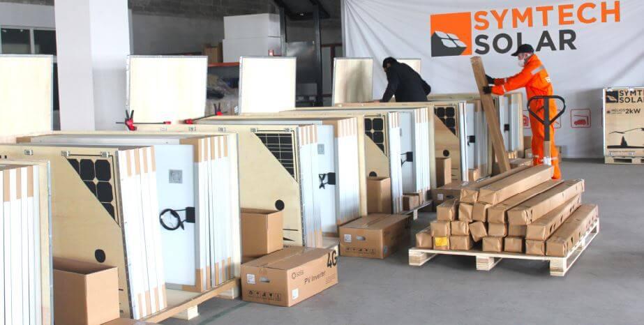 Geof Moser & Juan Castanon in the Symtech Solar Kit Factory 2017